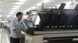 Operating Machinery in Standard Group Factory